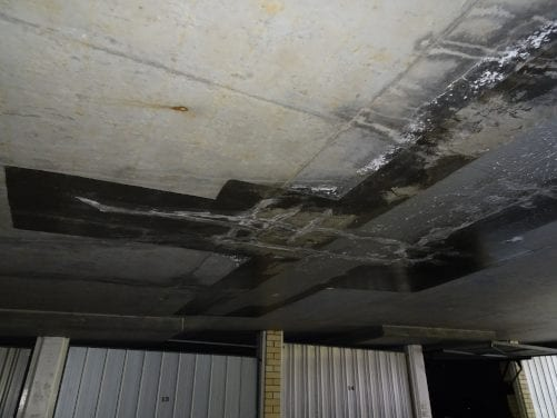 Seepage above unit garage
