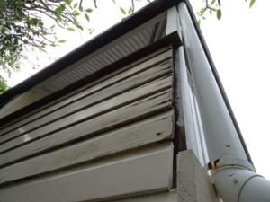 Queenslander style house with faulty and rotting weatherboards