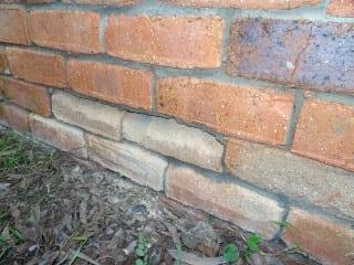 Salt damage to brick walls